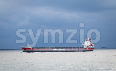 A cargo carrier of shipping company Wagenborg sails along Vlissingen Stock Photo