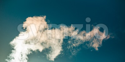Water vapor against a blue sky Stock Photo