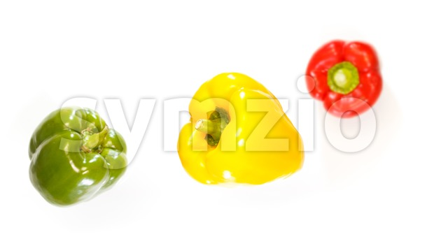 Top view of three peppers falling down Stock Photo