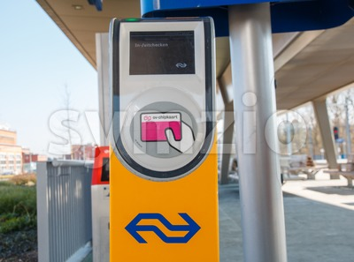 Public transport chipcard reader at a railway station in the Netherlands Stock Photo