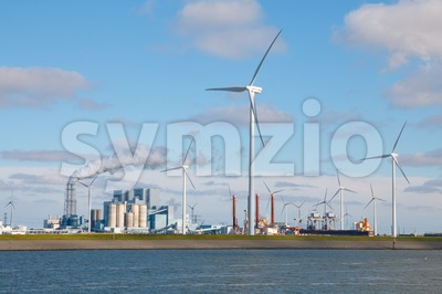 Electrical power generation from fossil fuels and wind energy Stock Photo