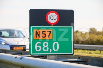 Combined kilometer marker and speed limit sign in the Netherlands Stock Photo