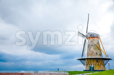 Traditional windmill on the dike in the Netherlands Stock Photo