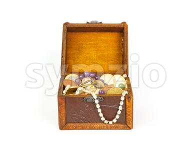 Open treasure chest with jewelry and money Stock Photo
