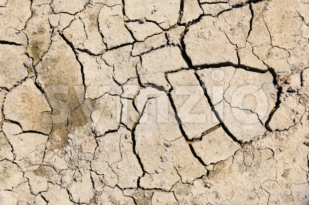 Top view of dry and cracked soil