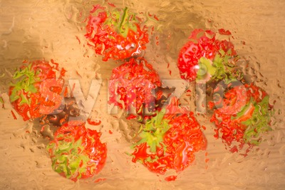 Strawberries under glass surface with water drops Stock Photo