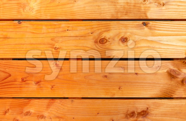 Background of orange oiled wooden planks of the Douglas fir