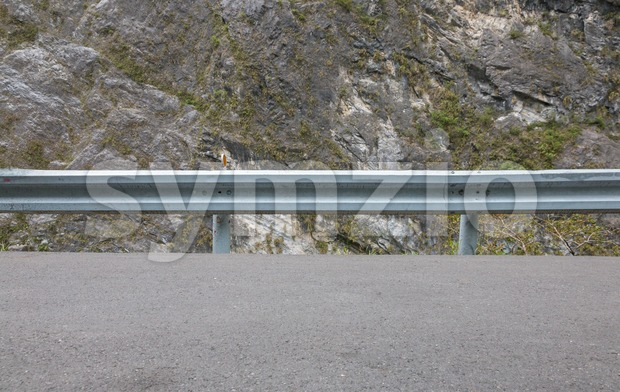 Guardrail on mountain road Stock Photo