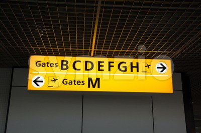 Illuminated sign at airport with gate numbers Stock Photo