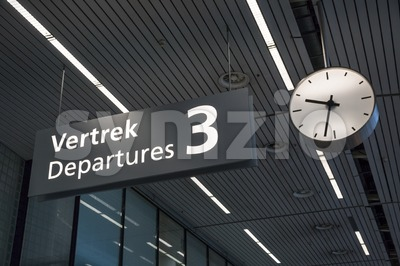 Sign to departures terminal at airport Stock Photo