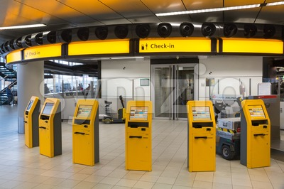 Check-in kiosks at Amsterdam Schiphol Airport Stock Photo