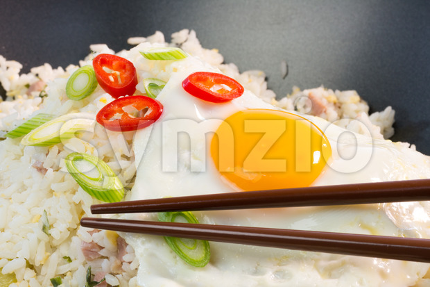 Indonesian Nasi Goreng with fried egg and chopsticks Stock Photo