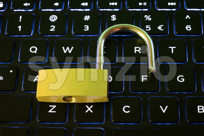 Open security lock on backlit computer keyboard Stock Photo