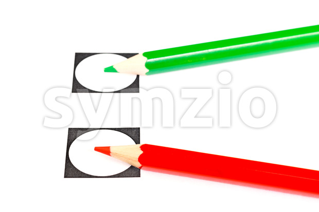 Vote with a green or red pencil Stock Photo