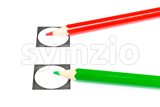 Vote with a red or green pencil Stock Photo