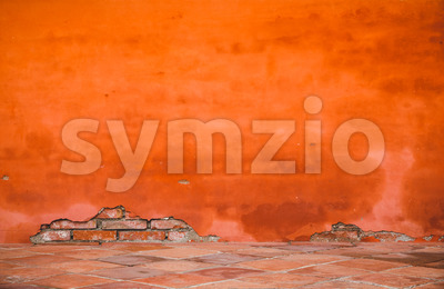 Oriental orange-red brick wall Stock Photo